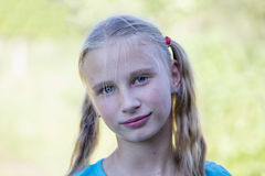 Beautiful young girl outdoors, portrait children close up Stock Images