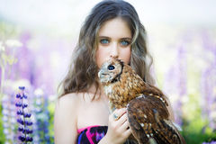 Beautiful young girl with owl Stock Photo