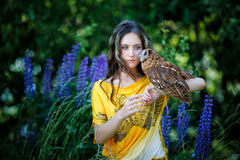 Beautiful young girl with owl Stock Photography