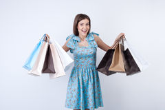 Beautiful young girl with packets is buying Stock Image