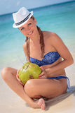 Beautiful young girl in paradise drinking coctail Stock Photography