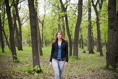 Beautiful young girl in park Royalty Free Stock Photo