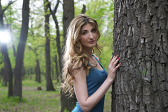 Beautiful young girl in park Stock Photo