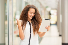 Beautiful young girl paying by credit card for Stock Image