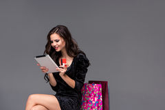 Beautiful young girl paying by credit card for Royalty Free Stock Photo