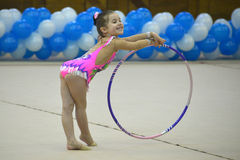 Beautiful young girl performing floor exercise during gymnastics competition Stock Images