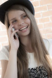 Beautiful young girl with phone Royalty Free Stock Images