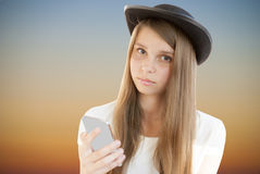 Beautiful young girl with phone Stock Photo