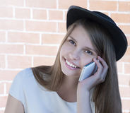 Beautiful young girl with phone. Royalty Free Stock Images