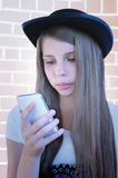 Beautiful young girl with phone. Royalty Free Stock Image
