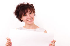 Beautiful young girl with a piece of white paper Royalty Free Stock Photography