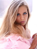 Beautiful young girl in pink dress Stock Photography