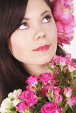 Beautiful young girl with pink flowers Stock Photo