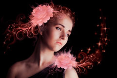 Beautiful young girl with pink flowers Stock Image