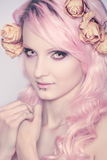 Beautiful and young girl with pink hair royalty free stock image