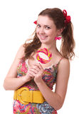 Beautiful young girl with pink spiral lollipops Stock Photography