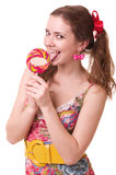 Beautiful young girl with pink spiral lollipops Royalty Free Stock Photography