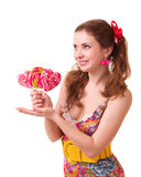 Beautiful young girl with pink spiral lollipops Royalty Free Stock Image