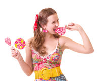 Beautiful young girl with pink spiral lollipops Royalty Free Stock Photos