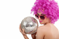 Beautiful young girl with pink wig holding disco ball,isolated stock photo