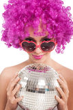 Beautiful young girl with pink wig holding disco ball,isolated stock image
