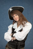 Beautiful young girl in pirate hat on blue Royalty Free Stock Photography