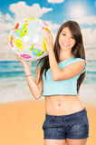 Beautiful young girl playing with beach ball Royalty Free Stock Image