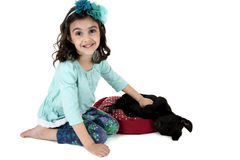 Beautiful young girl playing with black labrador puppy Stock Photography