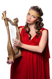 Beautiful young girl playing the harp Stock Photo