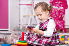 Beautiful young girl playing inside royalty free stock image