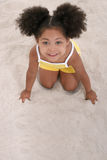 Beautiful Young Girl Playing In the Sand Stock Photos