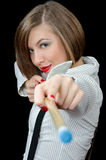 Beautiful young girl points with biliard cue Royalty Free Stock Image
