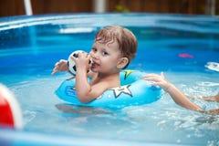 Beautiful young girl in pool Stock Photos
