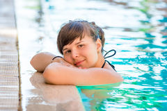 Beautiful young girl in the pool. Portrait of a beautiful young girl in the pool Royalty Free Stock Images