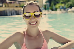 Beautiful young girl in pool. Beautiful smiling young girl in pool. Vintage photo Stock Image