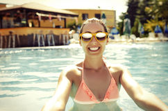Beautiful young girl in pool. Beautiful smiling young girl in pool. Vintage photo Stock Images