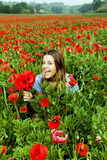 Beautiful young girl in a poppy field Stock Photo