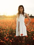 Woman on poppy field. Beautiful young girl on poppy field with dress royalty free stock photos