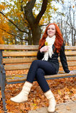 Beautiful young girl portrait sit on bench in park with yellow l Stock Image