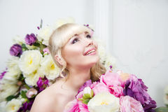 Beautiful young girl portrait in spring flowers. Beautiful blonde young girl portrait in spring flowers Royalty Free Stock Photos