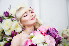 Beautiful young girl portrait in spring flowers Stock Photos