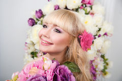 Beautiful young girl portrait in spring flowers. Beautiful blonde young girl portrait in spring flowers Stock Photography