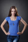 Beautiful young girl posing in casual clothes Stock Photo