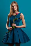 Beautiful young girl posing in dress with rose Stock Photo
