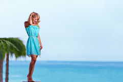 Beautiful young girl posing in front of the sea Royalty Free Stock Photos