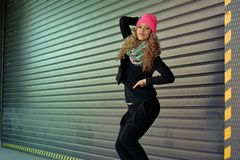 Beautiful young girl posing for garage doors Royalty Free Stock Photo