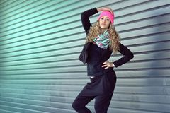 Beautiful young girl posing for garage doors Royalty Free Stock Photos