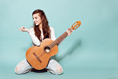 Beautiful young girl posing with guitar Stock Images