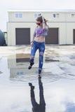Beautiful young girl posing near the garage. Royalty Free Stock Photo