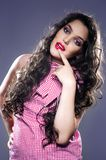 Beautiful young girl posing on photo shoot. Developing dark hair with a changing facial expression stock photography